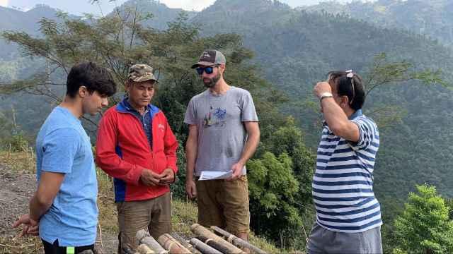 Dan Maurer and lead coffee farmer sharing ideas in Rasuwa, Nepal